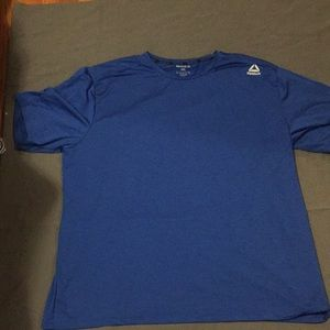 A blue Reebok short sleeve shirt